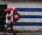Cuba-bandera-lluvia-580x377